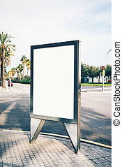 Blank lightbox on the street of a city. Vertical