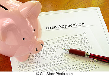 Blank loan application form with piggy bank