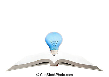 blank magic book with reading light bulb