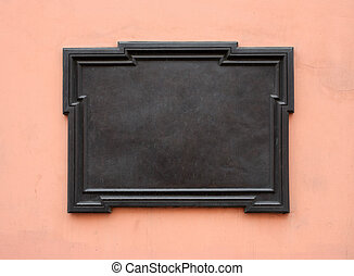 Blank cast-iron plaque on stone wall. Add your own text or image. Clipping path is included
