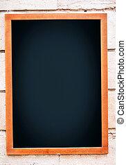 Blank menu board hanging on wall