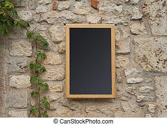 Blank Menu board outside a French restaurant