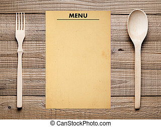 Blank menu, fork and spoon on wooden table