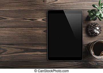Blank modern digital tablet with coffee cup and green plant on a wooden desk. Top view. High quality detailed graphic collage