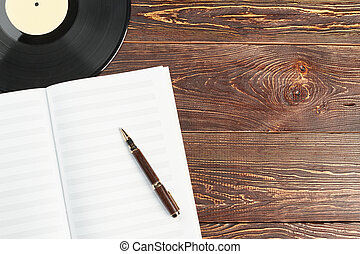 Blank music notebook and vinyl plates.