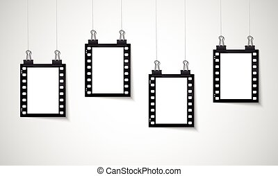 Blank negative film hanging on a line - Vector EPS 10...