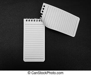 Blank Note book mock up on black background .
