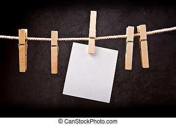 Blank note paper on rope with clothes pins