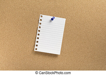 Blank note paper with blue push pin on a cork board