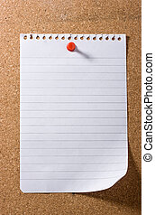 Blank creased rolled up page on cork board held on by red pushpin. Isolated on white.