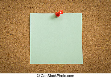 Blank note paper with a red push pin on cork board