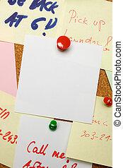 Blank note pinned on cork board - Blank paper note pinned on...
