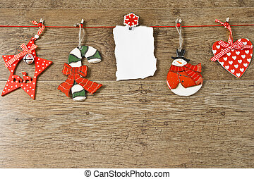 blank note with christmas decoration on wooden background