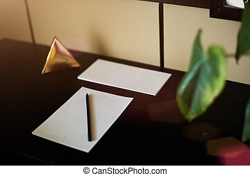 Blank notebook and smartphone with pencil on Laptop wooden table. The view from the top