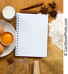 notebook for recipes with baking ingredients