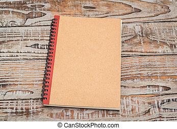 Blank notebook mock up on wood background .