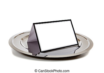 Blank notebook on a silver tray