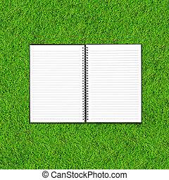 Blank notebook on Green Grass background