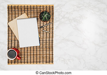 Blank notebook page on white marble table background
