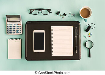 Blank notebook with cup of coffee on desk office