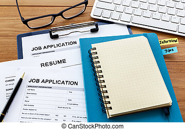 Blank notebook with job application
