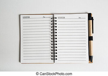 blank notebook with pen and pencil