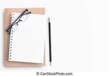 Blank notebook with pencil and eyeglasses on white background