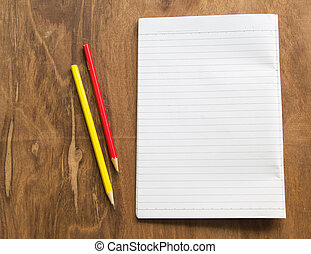Blank notebook with pencil on wooden table, business concept