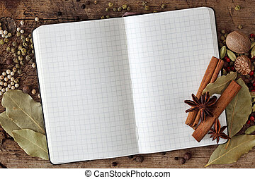 Blank notebook with spices