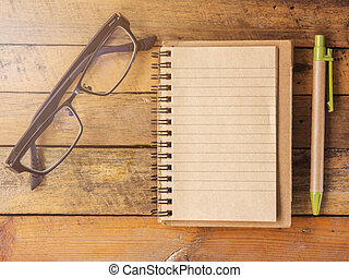 Blank notebooks and glasses