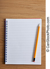 Photo of a blank ruled notepad and pencil on a desk, add your own copy.
