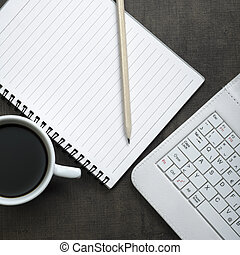 Blank notepad, laptop and coffee cup