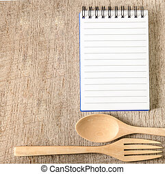 Blank notepad on wooden