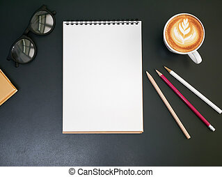 Blank notepad pencil on office desk with coffee cup ,top view
