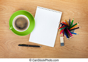Blank notepad with office supplies and green coffee cup