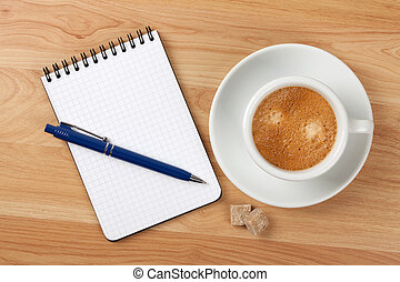 Blank notepad with pen and cappucino cup