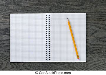 blank notepad with pencil on gray wood table