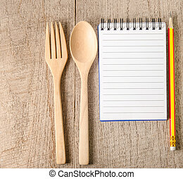 Blank notepad with pencil on wooden