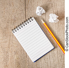 Blank notepad with pencil on wooden table