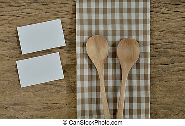Blank notepad with utensils on a wooden surface