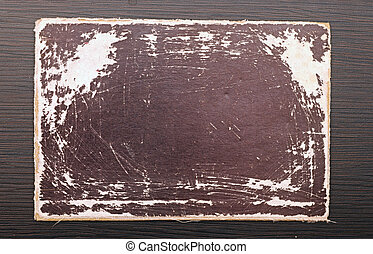 Blank old paper on wood