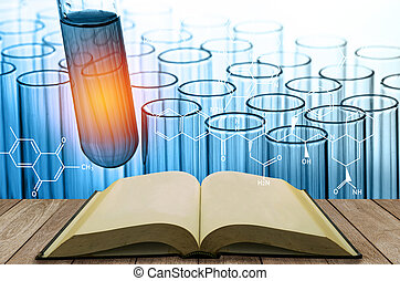 blank open book with science laboratory test tubes background
