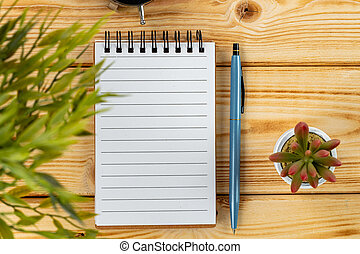 Blank open notepad with copy space on office table