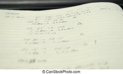 Blank page notebook paper with pen. Blank notebook with a pen resting on it. Notebook close up