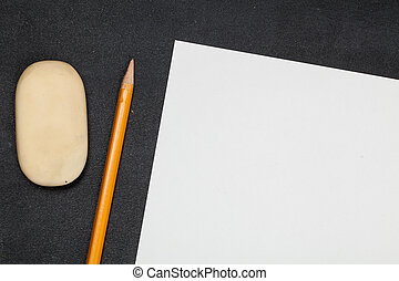 Blank paper and pencils with