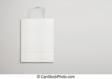 Blank paper bag with handles. 3D rendering