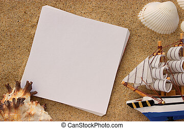 blank paper in the sand