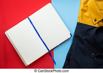 Blank paper notebook and businessman shirt.