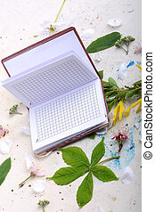 Blank paper notebook on white vintage background with scrapbooking elements
