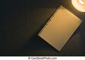 Blank paper on office wall